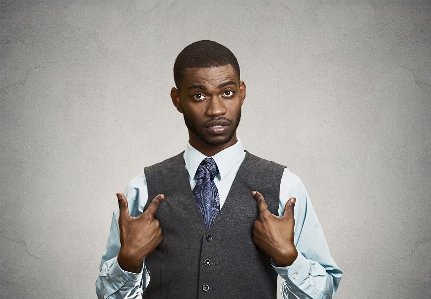 Black-man-pointing-at-self
