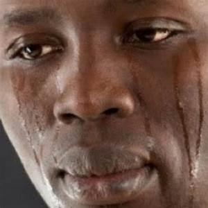 black man crying